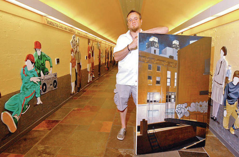 Hour photo / Erik TrautmannLocal artist Duvian Montoya whose work is popping up locally in prominent places has a permanent exhibition at Sono train station as part of the Art in Parking Places initiative in Norwalk. / (C)2012, The Hour Newspapers, all rights reserved
