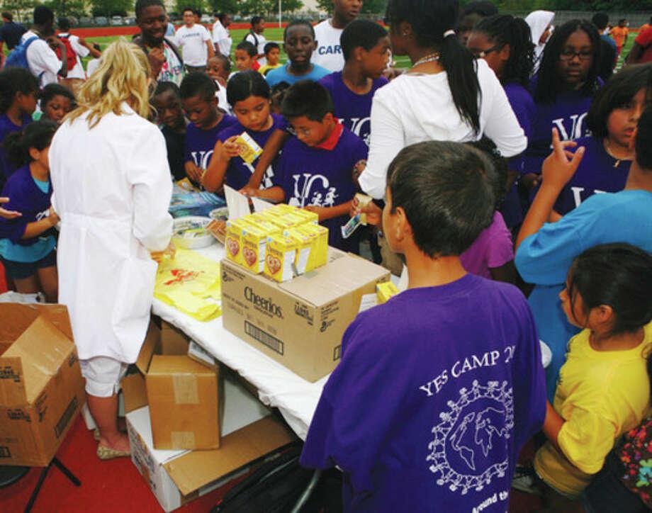 Photo by Olivier Kpognon Children visit the ShopRite Grade A nutrition table.