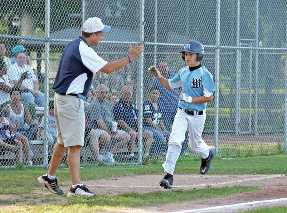Hour photo/Danielle RobinsonWilton's Billy Black, right, high fives his father and coach Kevin Black, while rounding third base after hitting a home run during a 12-year-old All-Star District 1 Little League game against Federal at National Lione Field at Scalzi Park in Stamford Friday evening.