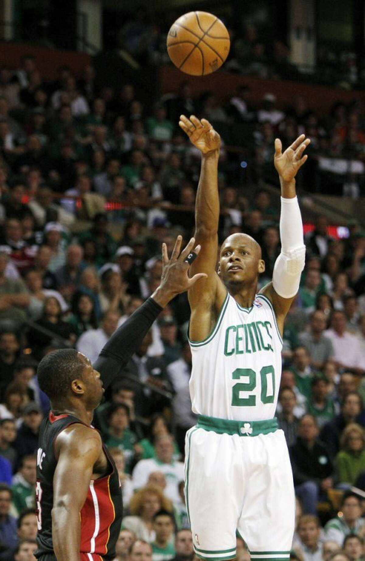 FILE - In this June 3, 2012, file photo, Boston Celtics guard Ray Allen (20) shoots a three-point basket over Miami Heat guard Dwyane Wade (3) during the first quarter of Game 4 in their NBA basketball Eastern Conference finals playoff series in Boston. Allen told the Heat on Friday night, July 6, 2012, that he has decided to leave the Celtics and join up with the reigning NBA champions. (AP Photo/Elise Amendola, File)