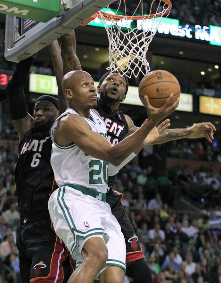 File - In this June 1, 2012, file photo, Boston Celtics guard Ray Allen (20) drives past Miami Heat forward LeBron James (6) and forward Udonis Haslem during the second quarter of Game 3 in the NBA basketball playoffs Eastern Conference finals in Boston. Allen told the Heat on Friday night, July 6, 2012, that he has decided to leave the Celtics and join up with the reigning NBA champions. (AP Photo/Elise Amendola, File)