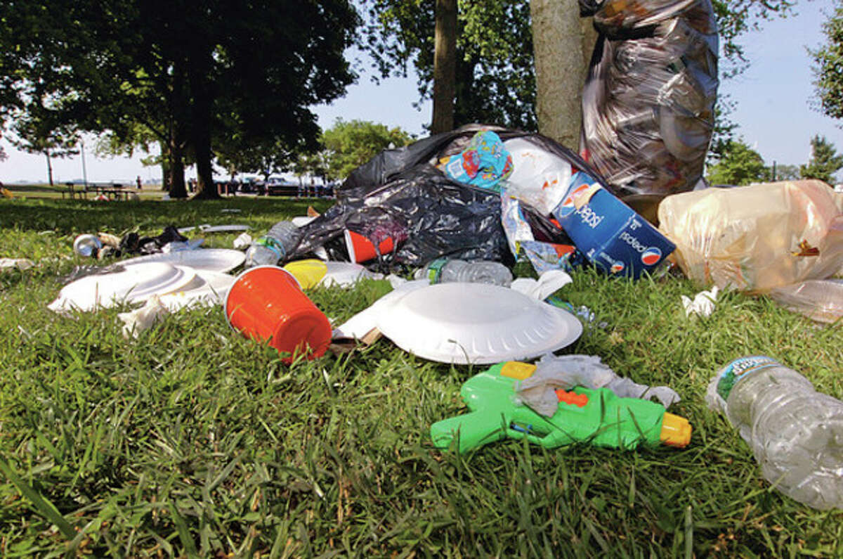 Garbage piled up Thursday morning at Shady Beach following the Independance Day holiday Wednesday when beachgoers jammed the park. Hour photo / Erik Trautmann