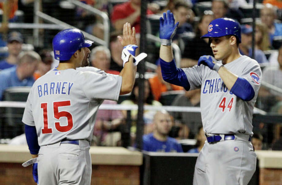 Chicago Cubs' Anthony Rizzo (44) celebrates with Darwin Barney (15) after hitting a three-run home run during the fifth inning of a baseball game against the New York Mets on Friday, July 6, 2012, in New York. (AP Photo/Frank Franklin II) / AP