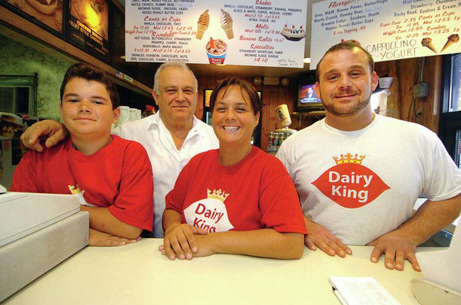 Hour photo by Alex von Kleydorff. Left to right, David Robledo, Savvas Ioannidis, Stacey Kodonis, and John Ioannidis at the family-owned Dairy King on Main Avenue in Norwalk that has been in business for 35 years. / 2011 The Hour Newspapers