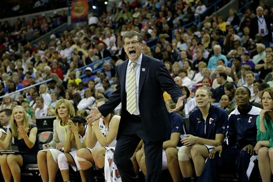 Connecticut head coach Geno Auriemma reacts to play against Louisville during first half of the national championship game of the women's Final Four of the NCAA college basketball tournament, Tuesday, April 9, 2013, in New Orleans. (AP Photo/Gerald Herbert) / AP