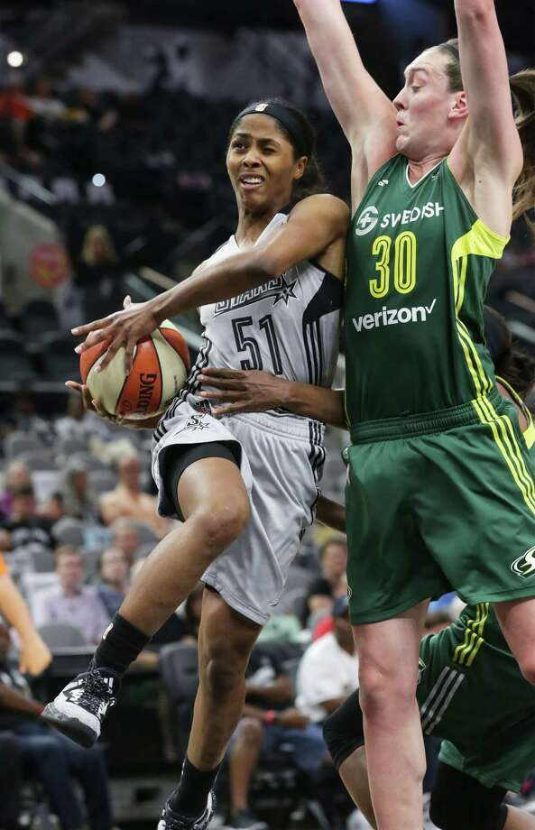 Sydney Colson drives to the hoop but is held as Breanna Stewart comes in to insure that she gets no shot as the Stars host Seattle on June 14, 2016. Photo: Tom Reel /San Antonio Express-News / 2016 SAN ANTONIO EXPRESS-NEWS
