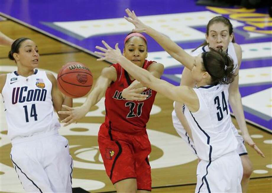 Louisville guard Bria Smith (21) passes the ball against Connecticut guard Kelly Faris (34) during first half of the national championship game of the women's Final Four of the NCAA college basketball tournament, Tuesday, April 9, 2013, in New Orleans. (AP Photo/Bill Haber) / FR170136 AP