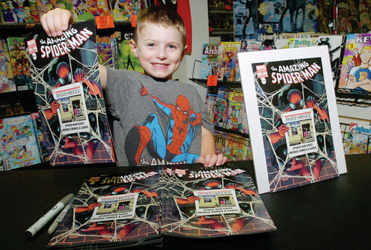 """Hour photos / Erik Trautmann Above, Ben Kruseski, 5, appears on the cover of ?'The Amazing Spider-Man #666.?"""" Krueski's dad, Dave Kruseski, owns Heroes Comics and Cards on Westport Avenue and submitted his store?•s photo, with his son Ben in the middle, to Marvel. This is the first issue that has ever had a photograph on the cover."""