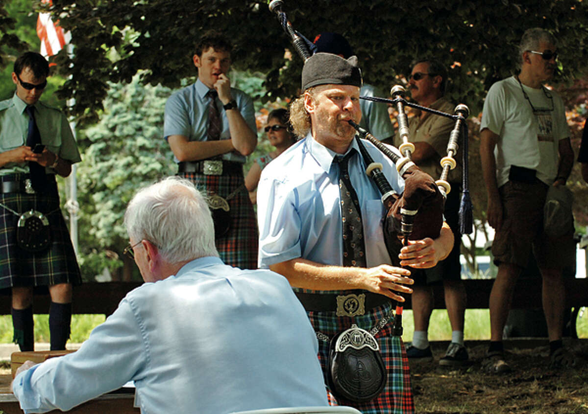 Matt Welch with the NY Metro Pipe Band is judged in the bagpipe competition during the Round Hill Highland Games at Cranbury Park Saturday. Hour photo / Erik Trautmann