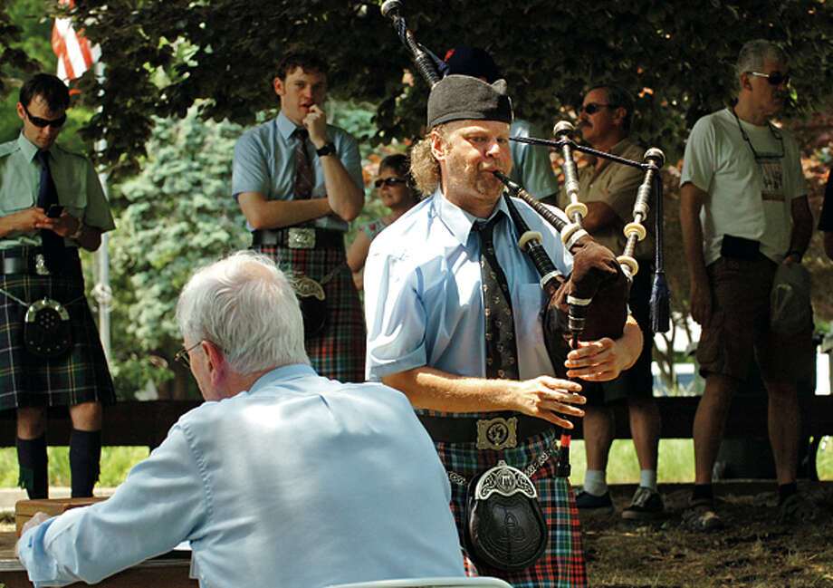 Matt Welch with the NY Metro Pipe Band is judged in the bagpipe competition during the Round Hill Highland Games at Cranbury Park Saturday. Hour photo / Erik Trautmann / (C)2012, The Hour Newspapers, all rights reserved