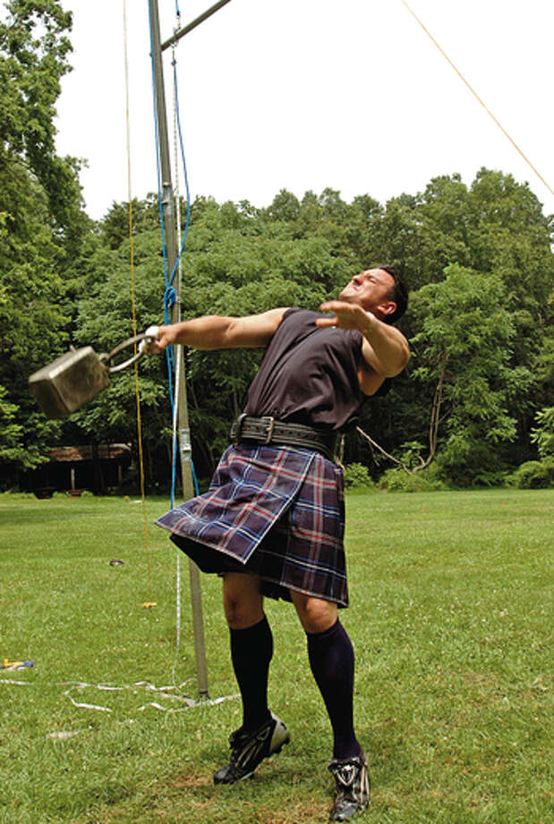 Ian McMahon tries to get the weight over the bar during the Round Hill Highland Games at Cranbury Park Saturday. Hour photo / Erik Trautmann / (C)2012, The Hour Newspapers, all rights reserved