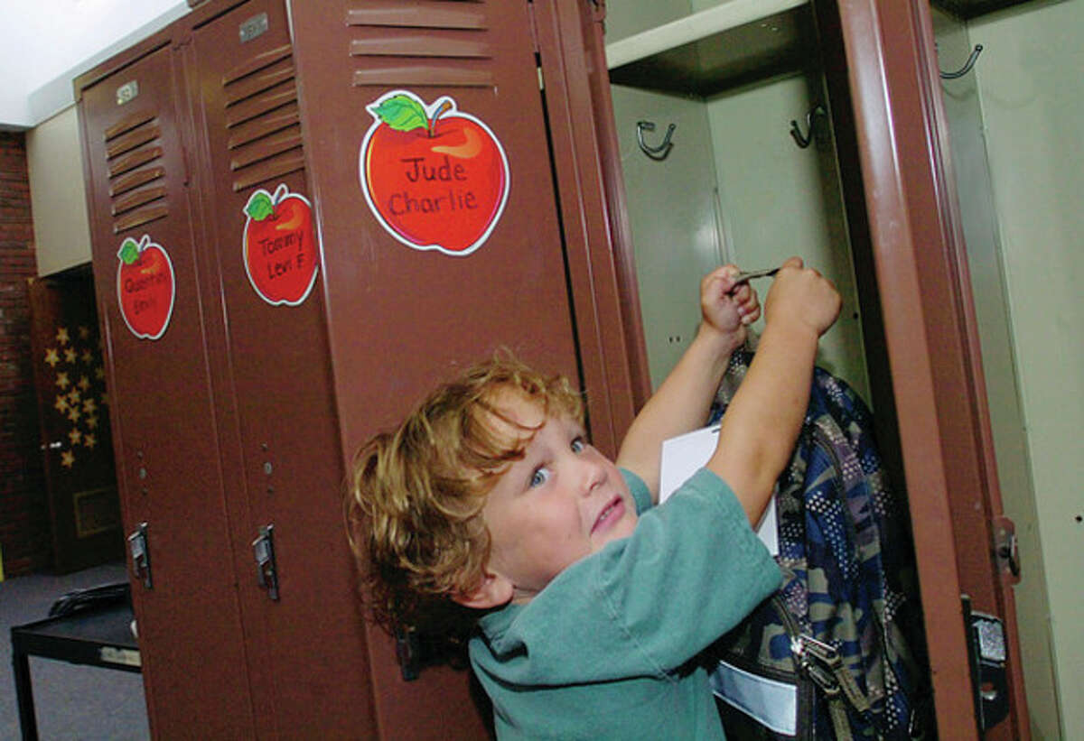 Miller Driscoll School kindergartner Brody Hess finds his locker on the first day of school Tuesday.