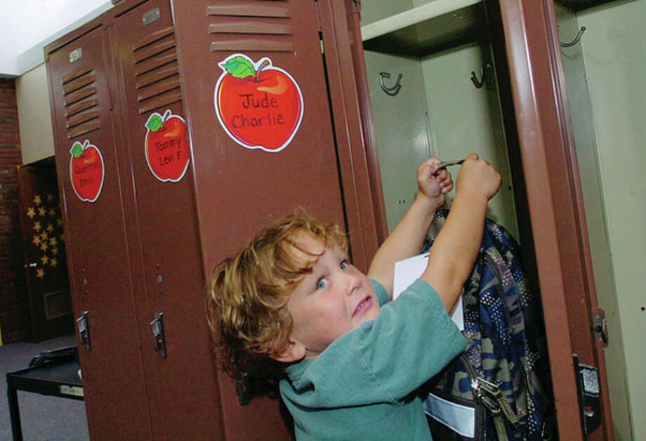 Miller Driscoll School kindergartner Brody Hess finds his locker on the first day of school Tuesday. / (C)2011, The Hour Newspapers, all rights reserved