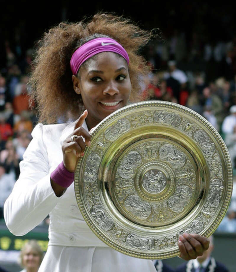 Serena Williams of the United States poses with her trophy after defeating Agnieszka Radwanska of Poland to win the women's final match at the All England Lawn Tennis Championships at Wimbledon, England, Saturday, July 7, 2012. (AP Photo/Kirsty Wigglesworth) / AP