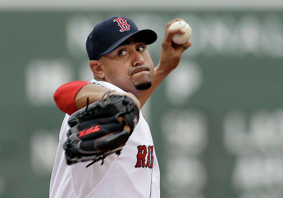 Boston Red Sox starting pitcher Franklin Morales delivers to the New York Yankees in the first inning of the first baseball game in a day-night doubleheader at Fenway Park in Boston, Saturday, July 7, 2012. (AP Photo/Elise Amendola) / AP