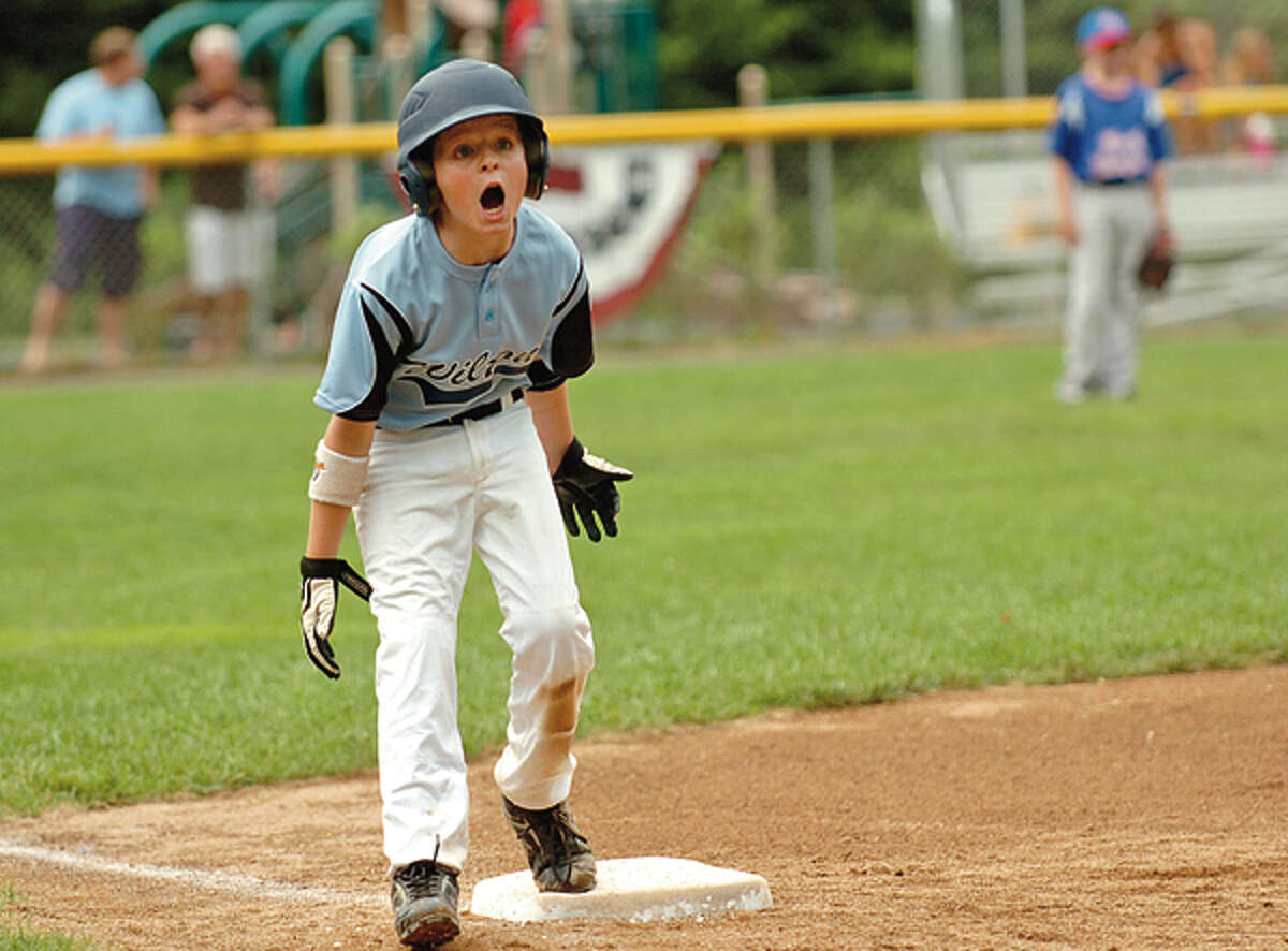 Wilton's Porter Ward ecourages his teammates during the 9 and 10 year old Little League District 1 Championship game against North Stamford in Darien Saturday. Hour photo / Erik Trautmann