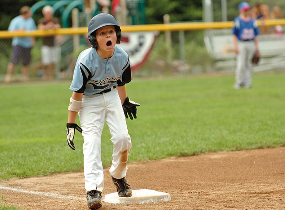 Wilton's Porter Ward ecourages his teammates during the 9 and 10 year old Little League District 1 Championship game against North Stamford in Darien Saturday. Hour photo / Erik Trautmann / (C)2012, The Hour Newspapers, all rights reserved