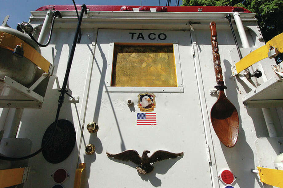 Hour Photo/ Alex von Kleydorff. You need big spoons to make big Tortas at Taqueria Las Salsas truck on Veterans Green in Norwalk / 2012 The Hour Newspapers