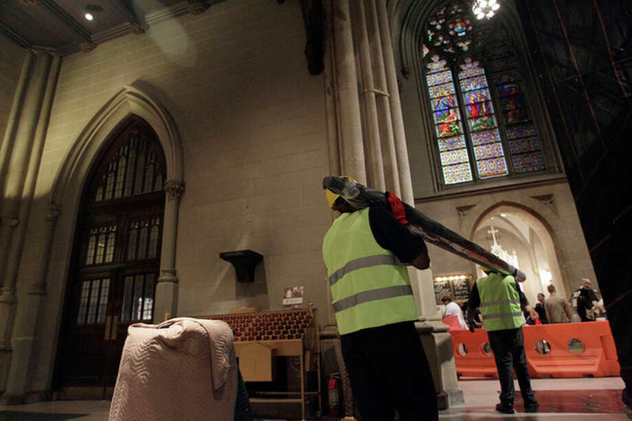 Construction workers remove the organ pipes from the choir loft at St. Patrick's Cathedral, Wednesday, June 20, 2012 in New York. The Cathedral has embarked on a $175 million facelift slated to last at least two years. (AP Photo/Mary Altaffer) / AP
