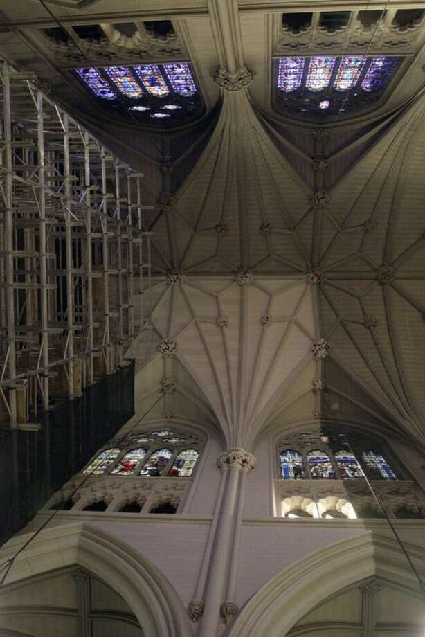 AP photo / Mary AltafferThis July 3 photo shows a portion of wall and ceiling, right, that has been cleaned during renovations at St. Patrick's Cathedral in New York.
