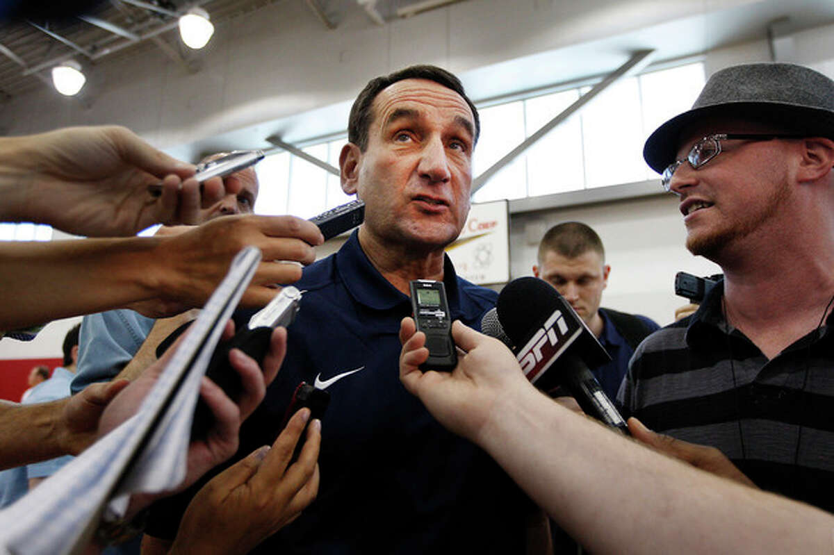 U.S. men's basketball coach Mike Krzyzewski talks with reporters during the tmen's practice at the Mendenhall Center on the UNLV campus in Las Vegas on Friday, July 6, 2012. (AP Photo/Las Vegas Review-Journal, Jason Bean) LOCAL TV OUT LOCAL INTERNET OUT LAS VEGAS SUN OUT