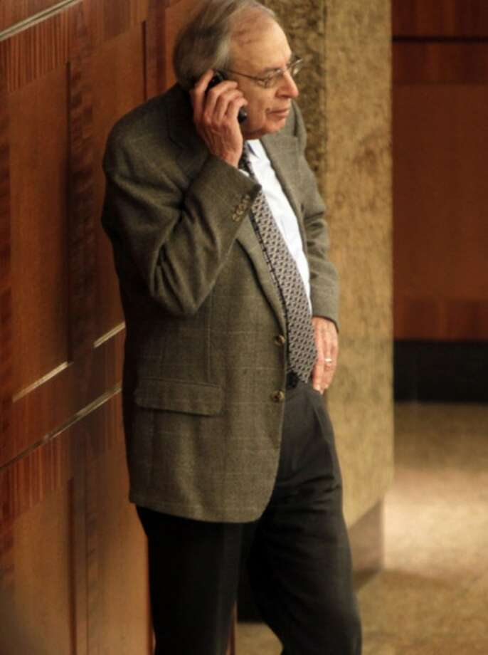 Federal mediator George Cohen talks on his mobile phone at the NBA labor negotiations, in New York, Wednesday, Oct. 19, 2011. NBA owners and players are meeting for a second straight day, shortly after finishing a 16-hour marathon. (AP Photo/Seth Wenig)