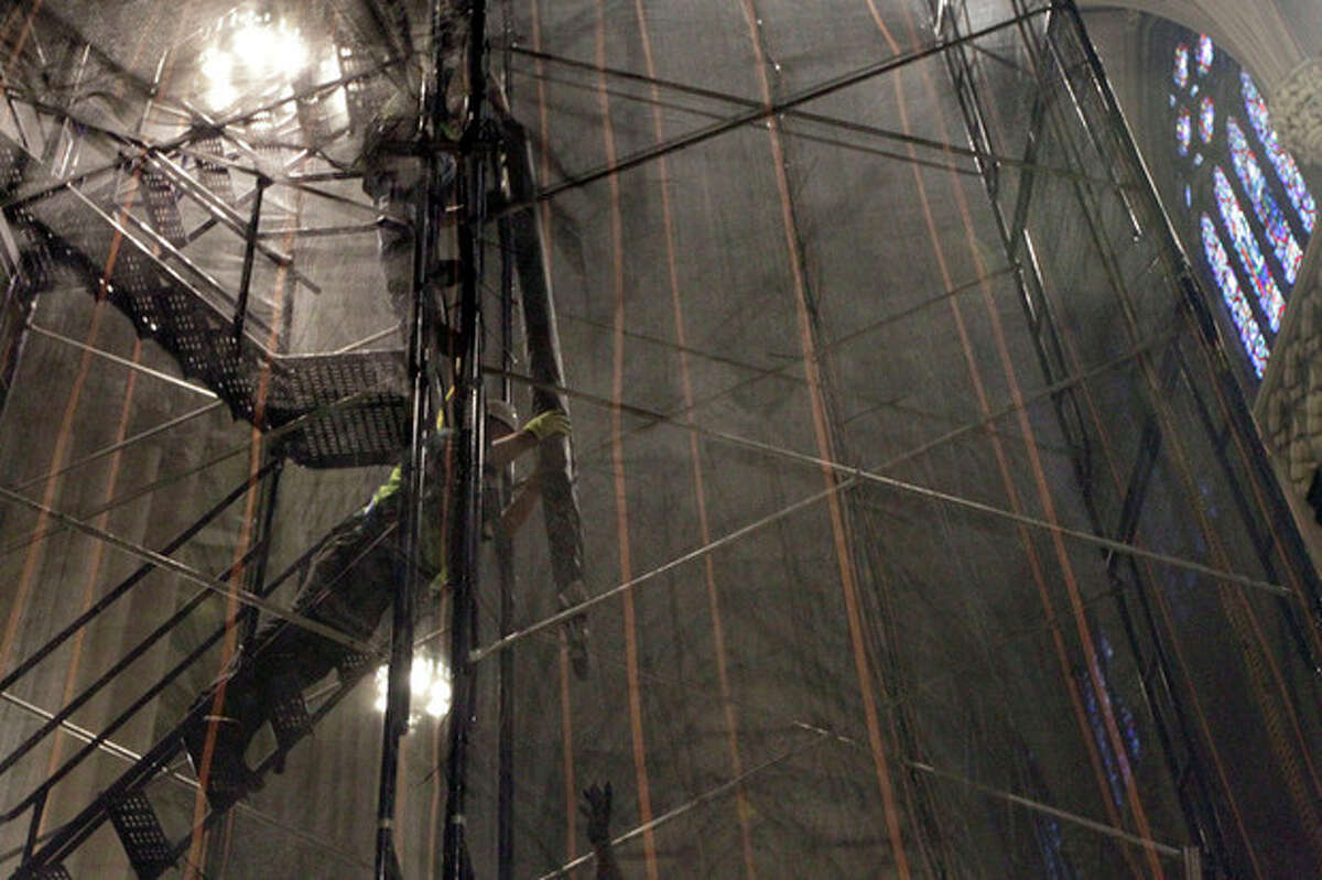 Construction workers remove the organ pipes from the choir loft at St. Patrick's Cathedral, Wednesday, June 20, 2012 in New York. The Cathedral has embarked on a $175 million facelift slated to last at least two years. (AP Photo/Mary Altaffer)