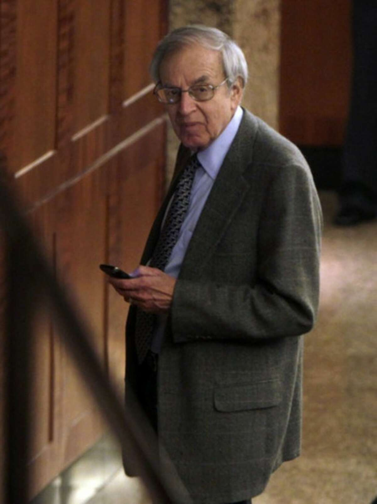 Federal mediator George Cohen uses a cell phone at the NBA labor negotiations, in New York, Wednesday, Oct. 19, 2011. NBA owners and players are meeting for a second straight day, shortly after finishing a 16-hour marathon. (AP Photo/Seth Wenig)
