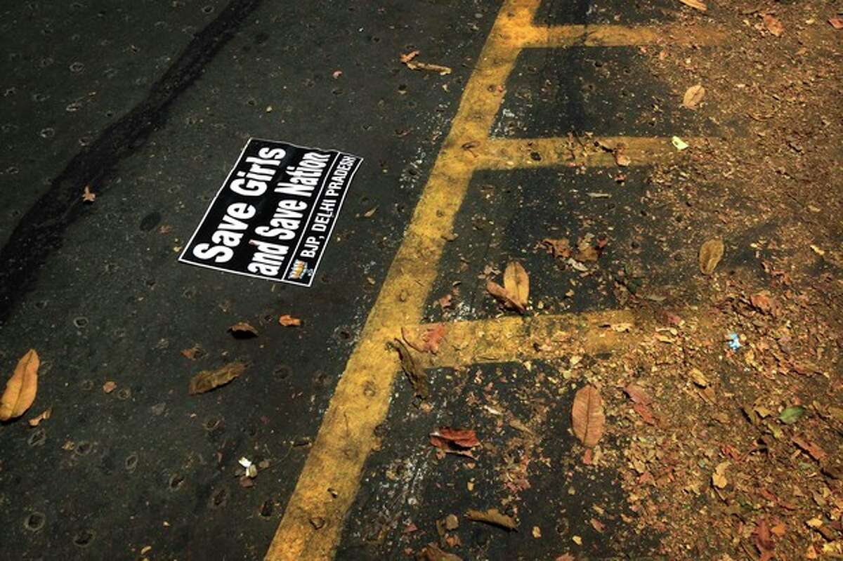 A banner lies on the road after a protest by Indian women activist of India main opposition Bharatiya Janata Party outside ruling United Progressive Alliance chairperson Sonia Gandhi?'s residence against the rape of a 5-year-old girl in New Delhi, India, Sunday, April 21, 2013. The girl was raped and tortured by a man who held her in a locked room in India's capital for two days. (AP Photo/Manish Swarup)