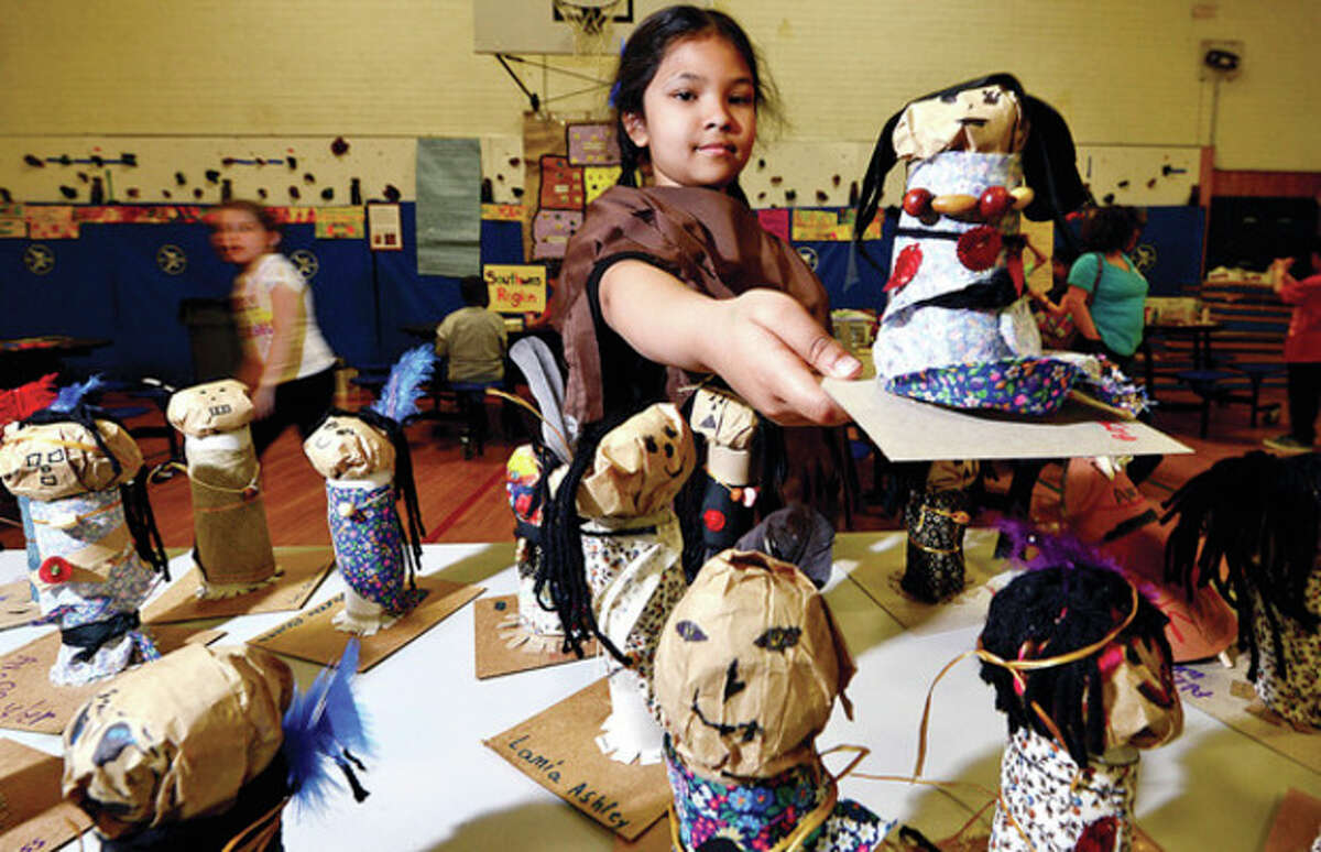 """Hour photo / Erik Trautmann Columbus Magnet School third grader, Roja Yousef, displays the 'authentic"""" Native American craft she made during the school's Native American Day Wednesday. All craft supplies were donated by the LilySarahGraceFund.org whose founder, Matthew Badger, tragically lost his daughters in the Christmas Eve fire in Stamford."""