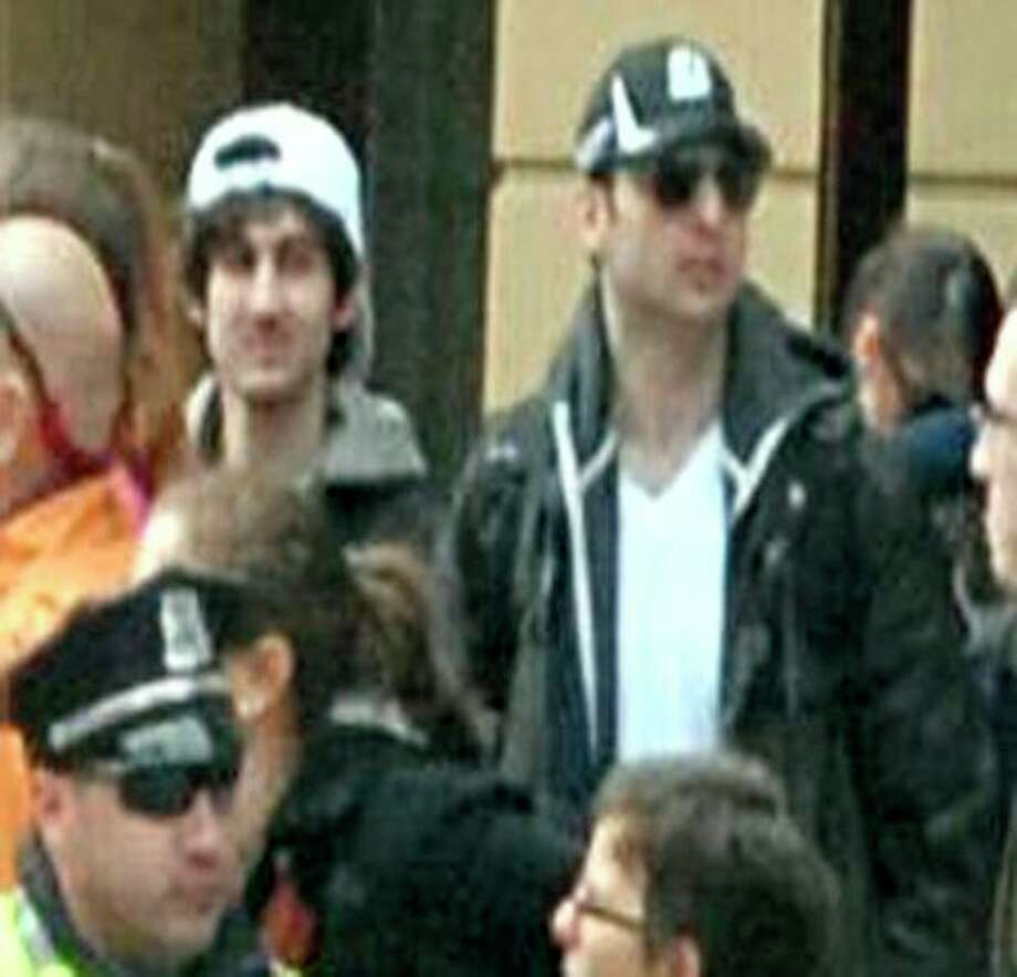 This photo released by the FBI early Friday April 19, 2013, shows what the FBI is calling the suspects together, walking through the crowd in Boston on Monday, April 15, 2013, before the explosions at the Boston Marathon. (AP Photo/FBI) / FBI