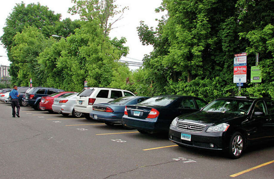 The Norwalk Redevelopment Agency will begin environmental remediation at South Norwalk Train Station in advance of the transit-oriented development. The first phase, slated for this summer, will involve the small parking area on New Haven-bound side and displace 60 parkers to an area of Dr. Martin Luther King Jr. Drive.Hour photo / Erik Trautmann / (C)2012, The Hour Newspapers, all rights reserved