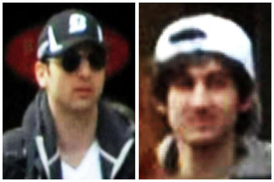 This combo of photos released by the Federal Bureau of Investigation early Friday April 19, 2013, shows what the FBI is calling suspects number 1, left, and suspect number 2, right, walking through the crowd in Boston on Monday, April 15, 2013, before the explosions at the Boston Marathon. (AP Photo/FBI) / FBI