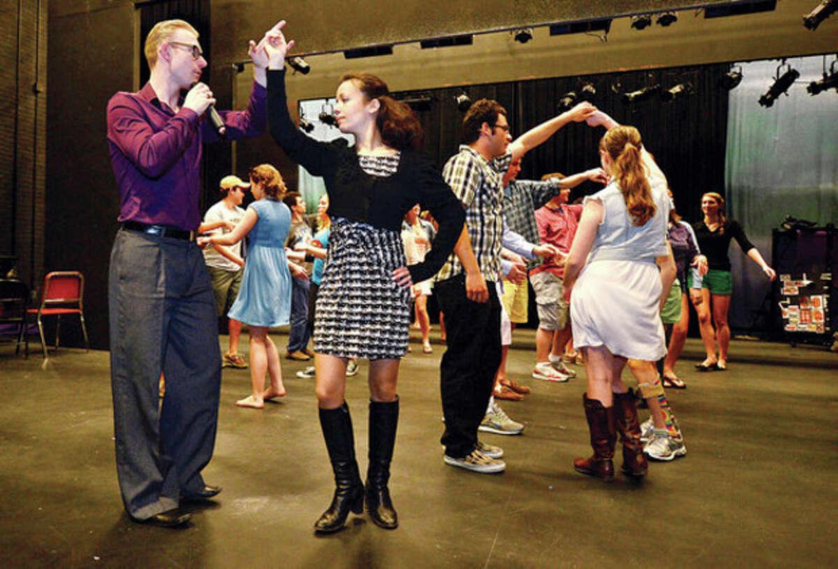 Professional dancers Morten Jensen and Mira Cherkezova teach Wilton High School students the Mrengue during the school's annual Festival of Languages Wednesday. Hour photo / Erik Trautmann