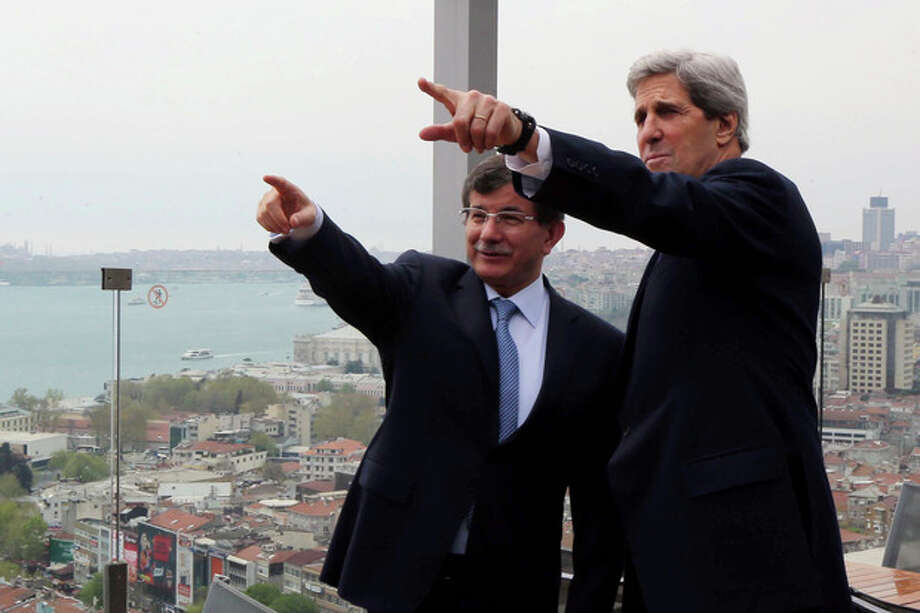 U.S. Secretary of State John Kerry, right, and his Turkish counterpart Ahmet Davutoglu point toward the Bosporus before a working lunch in Istanbul, Turkey, Sunday, April 21, 2013. Wrapping up a 24-hour visit to Istanbul, Kerry on Sunday sought to cement and speed up an improvement in relations between Turkey and Israel as well as explore new ways to relaunch Mideast peace efforts. President Barack Obama has made both issues foreign policy priorities for his second term and Kerry was pushing them in meetings with Abbas and Turkish Foreign Minister Ahmet Davutoglu.(AP Photo/Hakan Goktepe, Pool) / Pool Anadolu Agency