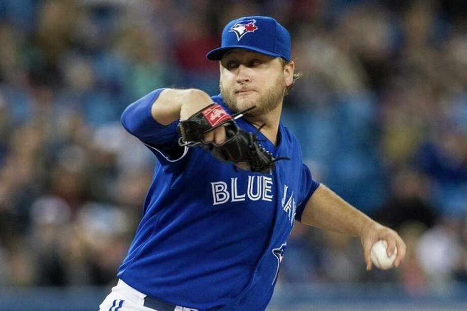 Toronto Blue Jays starting pitcher Mark Buehrle works against the New York Yankees during the first inning of a baseball game in Toronto on Saturday, April 20, 2013. (AP Photo/The Canadian Press, Chris Young) / CP