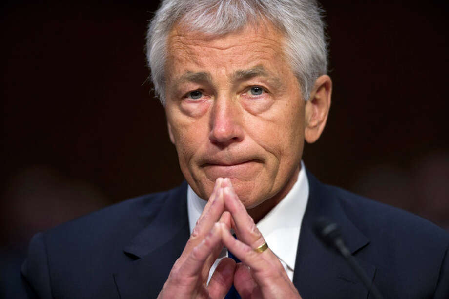 Defense Secretary Chuck Hagel listens on Capitol Hill in Washington, Wednesday, April 17, 2103, as he testified before the Senate Armed Services Committee hearing on the Pentagon's budget for fiscal 2014 and beyond. (AP Photo/J. Scott Applewhite) / AP