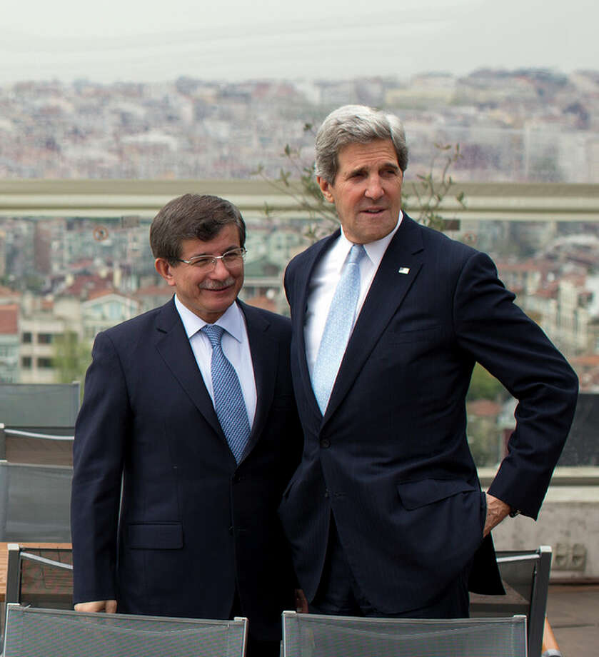 Turkish Foreign Minister Ahmet Davutoglu, left, shows U.S. Secretary of State John Kerry, the skyline of Istanbul before the start of a meeting on Sunday, April 21, 2013, in Istanbul, Turkey. Kerry is wrapping up a 24-hour visit to Istanbul with talks aimed at improving ties between Turkey and Israel and pushing ahead with Mideast peace efforts. (AP Photo/Evan Vucci, Pool) / AP