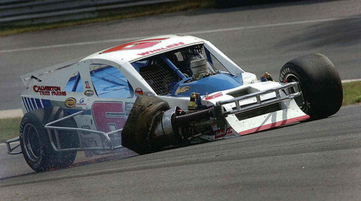 Hour Photo/Alex von Kleydorff Norwalk's Ron Silk comes through the chicane and the uphill with damage to the right front of his car during the NASCAR Whelen Modified Tour event Saturday at Lime Rock Park. Silk started second and ran among the leaders until being involved in a multi-car accident on lap 47. He finished 16th.
