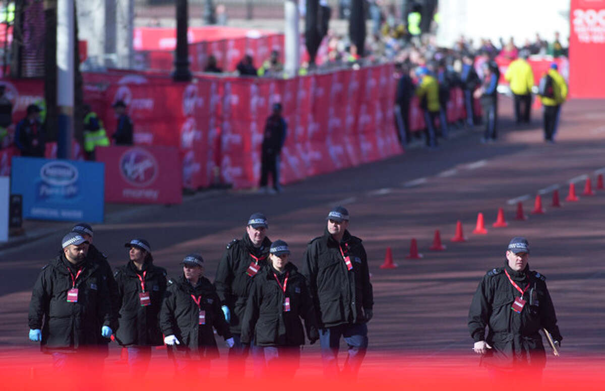 AP Photo/Alastair Grant British police officers make final checks in the Mall, prior to the beginning of the London Marathon near to the finish line for marathon is situated in London, Sunday, April 21.