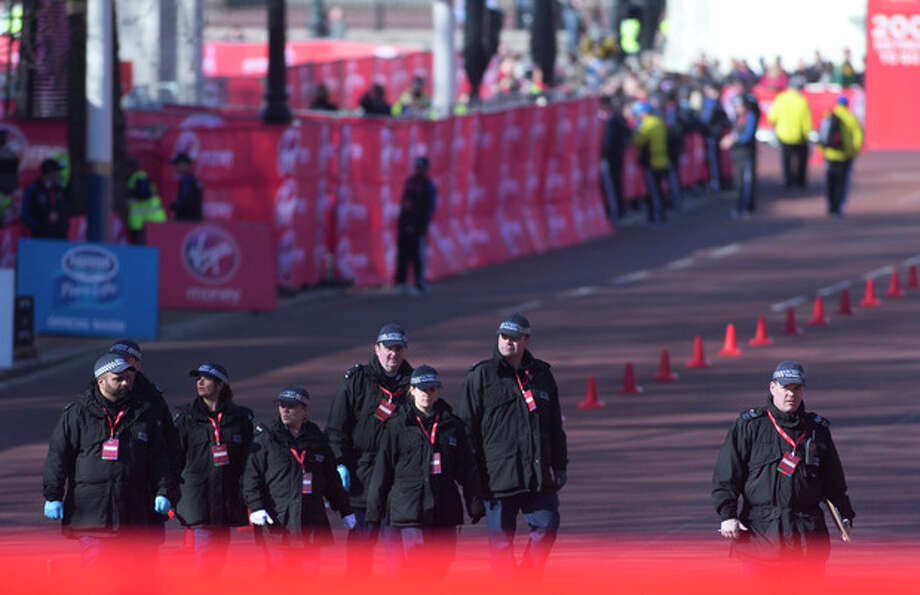 AP Photo/Alastair GrantBritish police officers make final checks in the Mall, prior to the beginning of the London Marathon near to the finish line for marathon is situated in London, Sunday, April 21. / AP