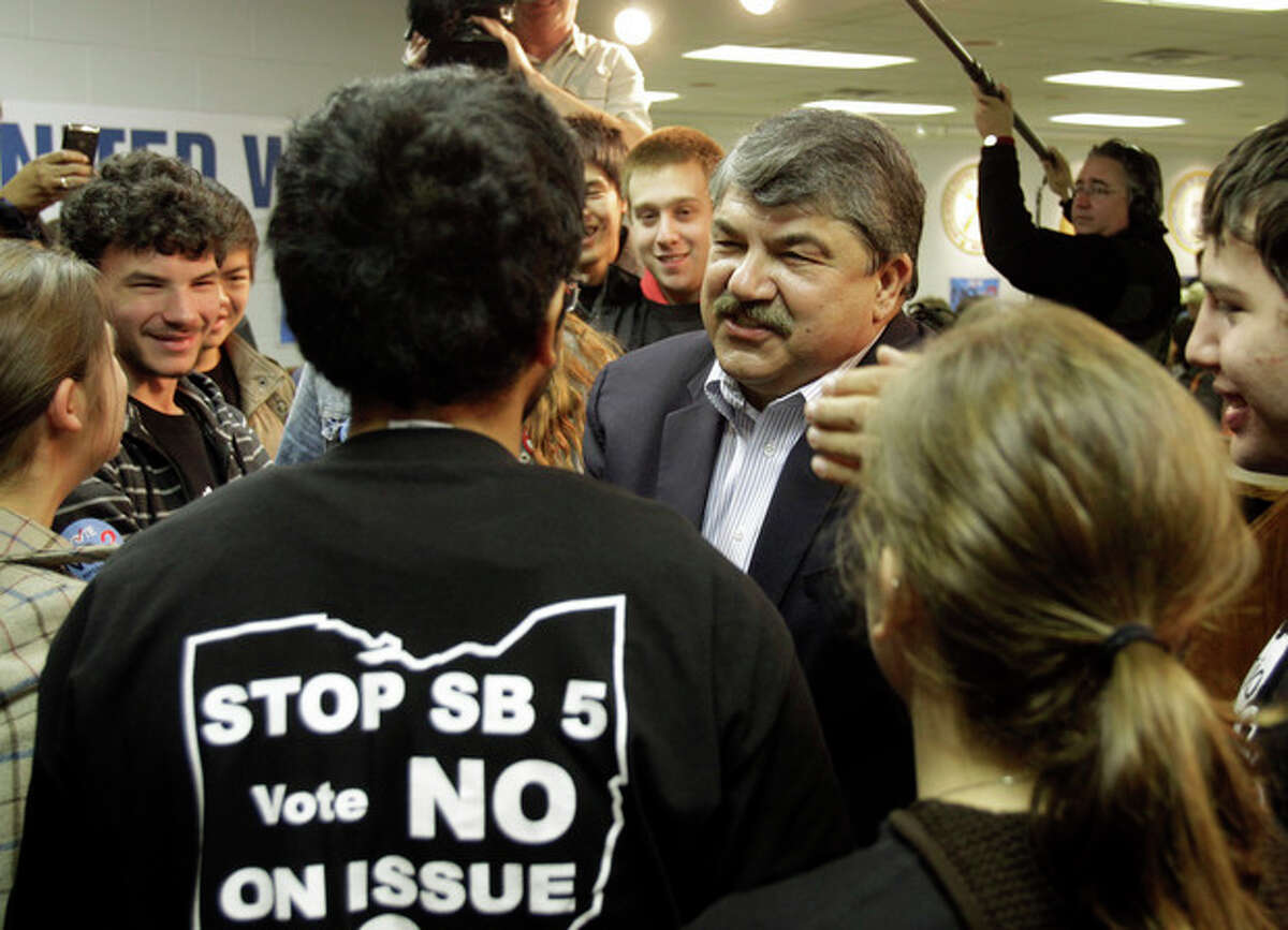 AFL-CIO president Richard Trumka, center, speaks with Columbia University students at a union hall in Cleveland Monday, Nov. 7, 2011. The students joined Trumka and local union members going door to door in the area urging a no vote on Ohio Issue 2. (AP Photo/Mark Duncan)