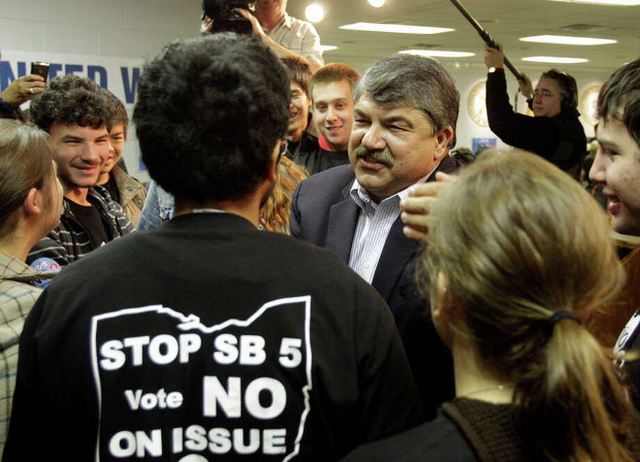 AFL-CIO president Richard Trumka, center, speaks with Columbia University students at a union hall in Cleveland Monday, Nov. 7, 2011. The students joined Trumka and local union members going door to door in the area urging a no vote on Ohio Issue 2. (AP Photo/Mark Duncan) / 2011 The Associated Press