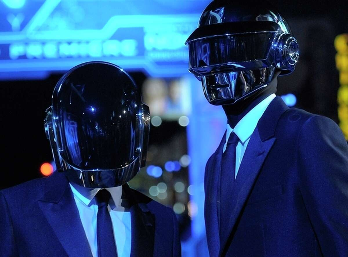 """FILE - In this Dec. 11, 2010 file photo, musician Guy-Manuel de Homem-Christo, left, and musician Thomas Bangalter of the duo Daft Punk arrive at the premiere of the feature film """"Tron: Legacy"""" in Los Angeles. Daft Punk have set a record on Spotify. The music service says the French electronic duo's song, """"Get Lucky,"""" had the biggest streaming day for a single track on Friday, April 19, 2013, in the United States and the United Kingdom. Spotify wouldn't release the number of streams.(AP Photo/Dan Steinberg)"""