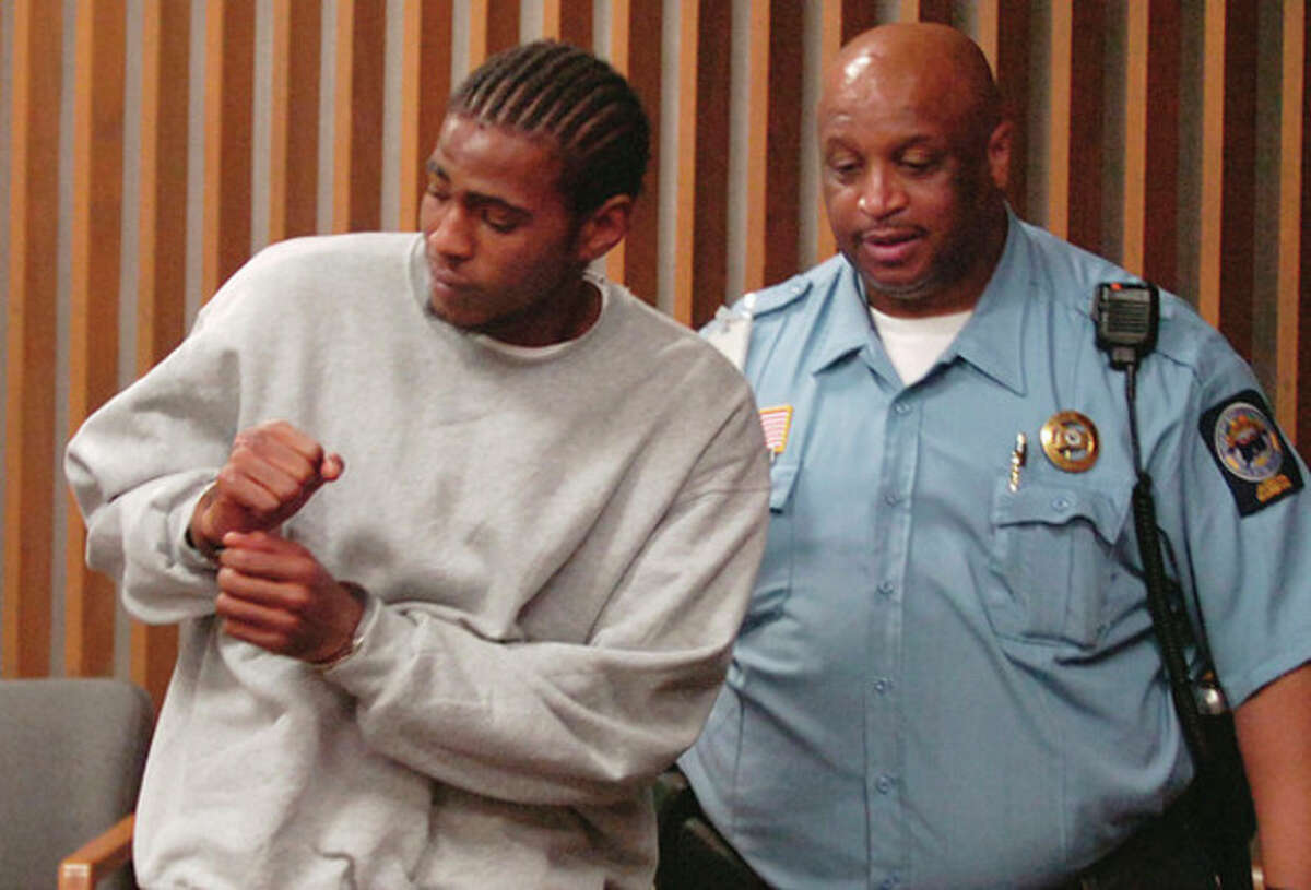 """Hour photo / Erik Trautmann Christopher Entzminger-Joyner, who goes by the street name """"Juney,"""" is led out of the courtroom following his arraignment Wednesday at Norwalk Superior Court on charges related to a triple shooting on Taylor Avenue."""