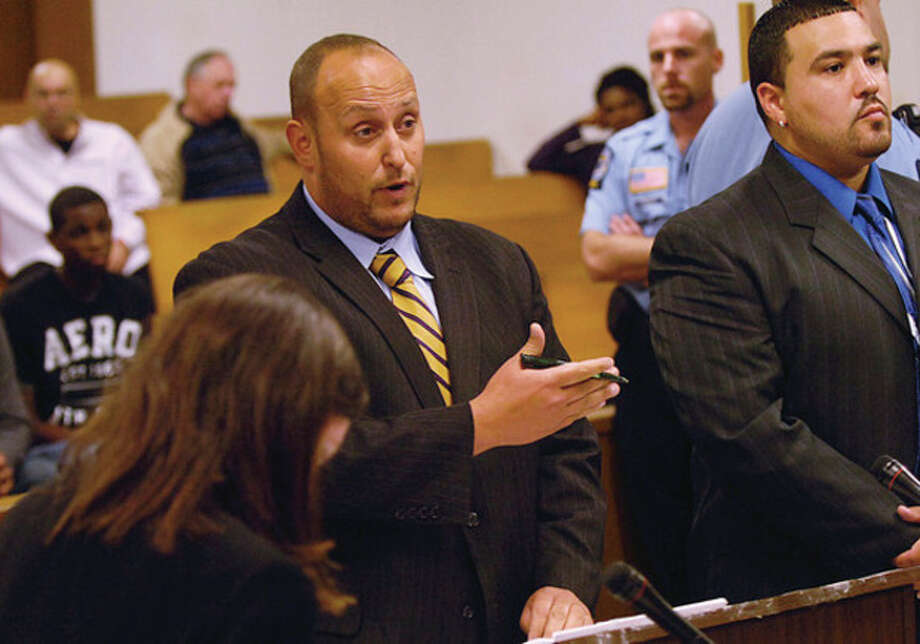 The Public Defender for Christopher Entzminger-Joyner, who goes by the street name Journey, during Entziminger's arraignment Wednesday at Norwalk Superior Court on charges relating to a triple shooting on Taylor Avenue / (C)2011, The Hour Newspapers, all rights reserved