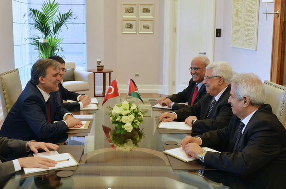 In this photo provided by Turkish Presidency Press Service,Turkey's President Abdullah Gul, left, and Palestinian leader Mahmoud Abbas, second right, seen during a meeting in Ankara, Turkey, Monday, April 22, 2013. U.S. Secretary of State John Kerry met with Abbas Sunday in Istanbul, in an effort to relaunch Mideast peace efforts, one of President Barack Obama's foreign policy priorities.(AP Photo/irfan Yildiz) / Turkish Presidency Press Office