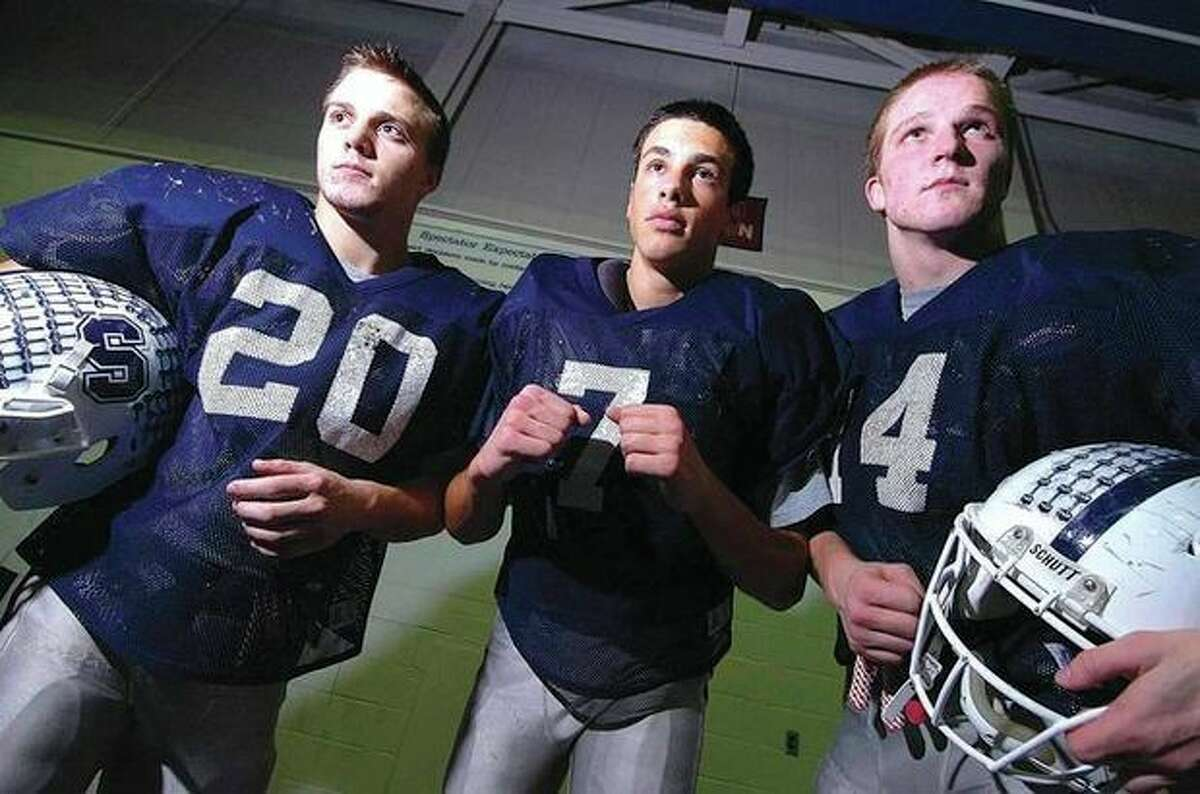Hour Photo/Alex von Kleydorff Staples will need a complete game from its linebacking corps if it is to have any success against Xavier in today's Class LL state championship game. From left, Robbie Wolf, Lance Lonergan and Peter Bonenfant are three of the 'backers that are ready to accept the challenge.