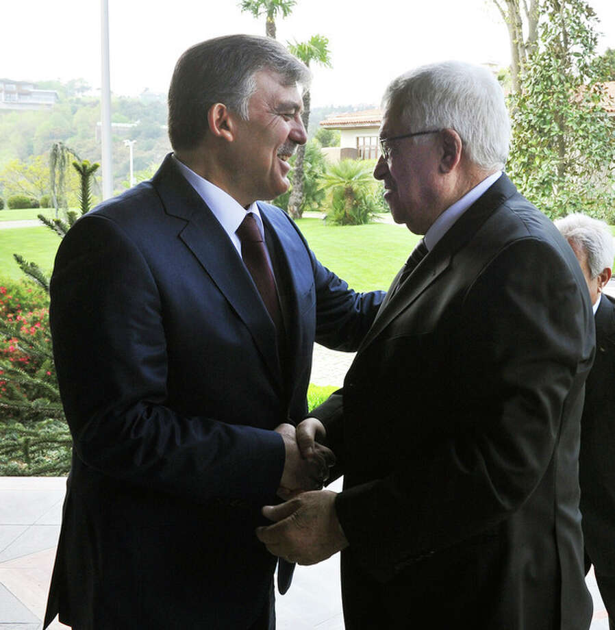 In this photo provided by Turkish Presidency Press Service,Turkey's President Abdullah Gul, left, greets Palestinian leader Mahmoud Abbas before a meeting in Ankara, Turkey, Monday, April 22, 2013. U.S. Secretary of State John Kerry met with Abbas Sunday in Istanbul, in an effort to relaunch Mideast peace efforts, one of President Barack Obama's foreign policy priorities.(AP Photo/irfan Yildiz) / Turkish Presidency Press Office