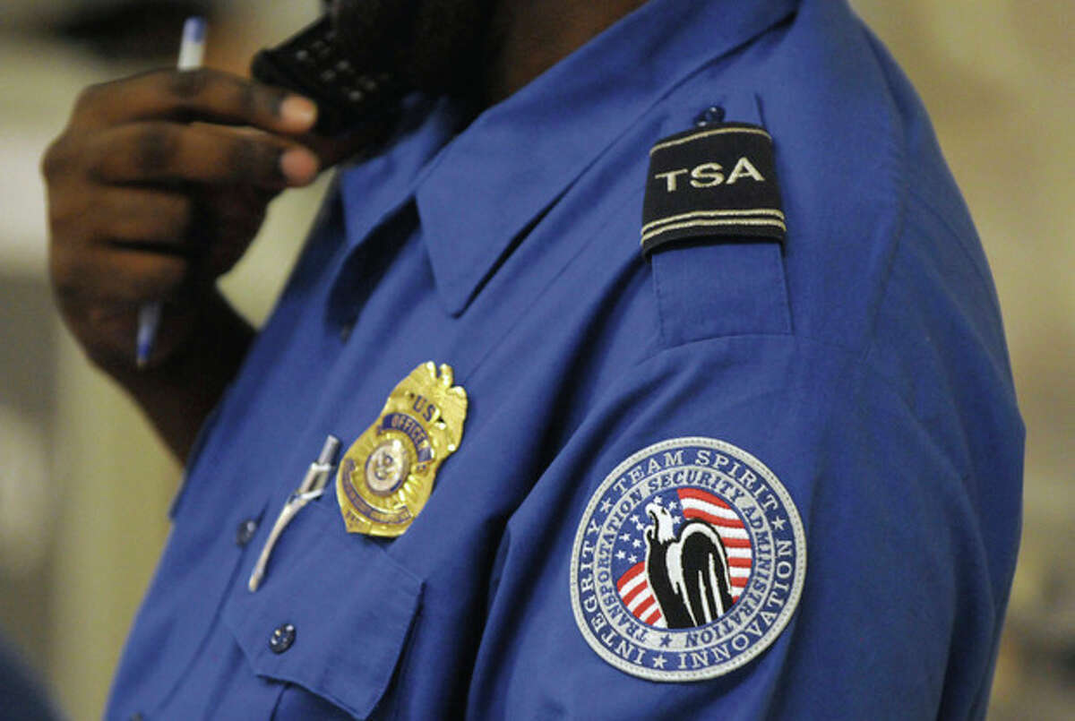 A Transportation Security Administration officer at the security checkpoint at Hartsfield-Jackson Atlanta International Airport on Wednesday August 3, 2011 in Atlanta. The TSA was created after the terrorist attacks of Sept. 11, 2001. (AP Photo/Erik S. Lesser)